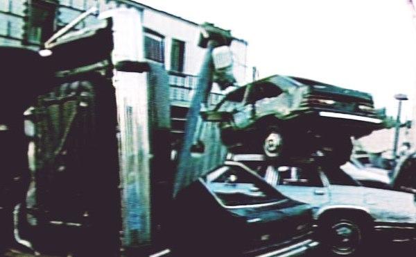 tornado 85 piled cars_143066