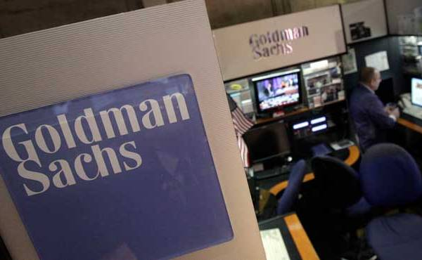 a-trader-works-in-the-goldman-sachs-booth-on-the-floor-of-the-new-york-stock-exchange_197548