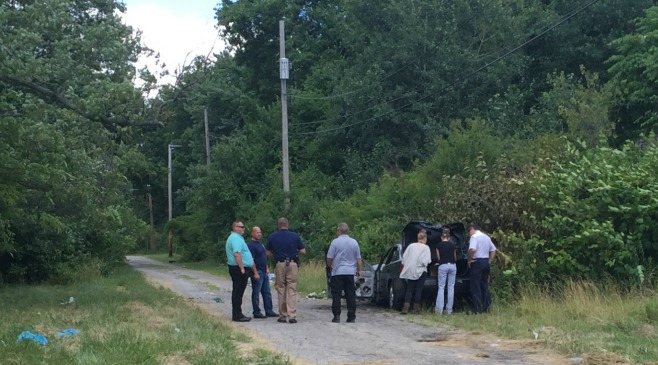 Youngstown Police are investigating a dead body found in a car on the side of the road.