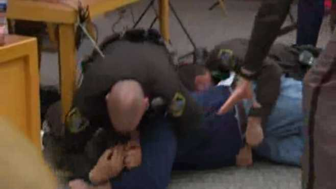 Father rushes Larry Nassar_500215