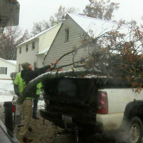 cleaning up after storm in Salem