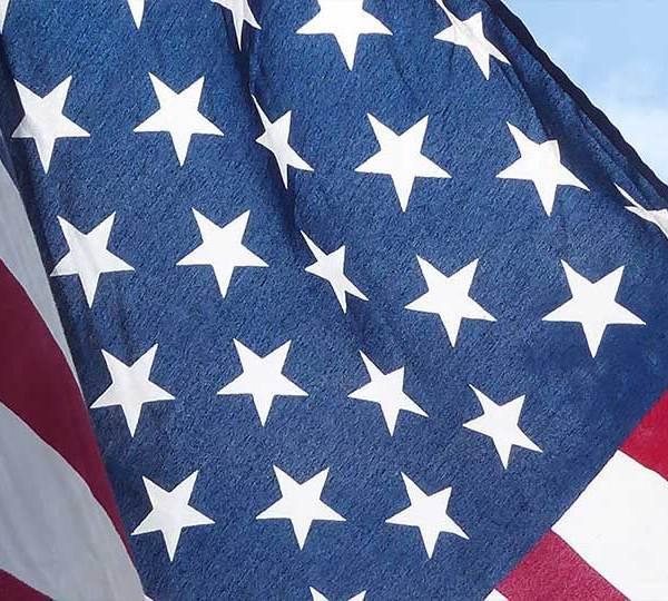 An American flag waving in the air.