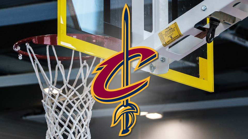 Cleveland Cavaliers logo in front of a basketball hoop.