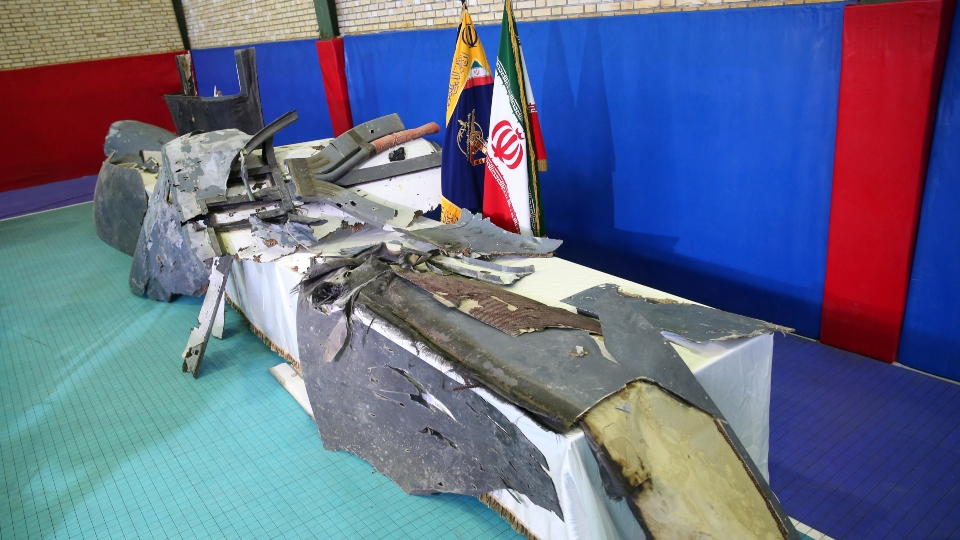 Debris from what Iran's Revolutionary Guard aerospace division describes as the U.S. drone which was shot down on Thursday is displayed in Tehran, Iran, Friday, June 21, 2019. Major airlines from around the world on Friday began rerouting their flights to avoid areas around the Strait of Hormuz following Iran's shooting down of a U.S. military surveillance drone there, as America warned commercial airliners could be mistakenly attacked.