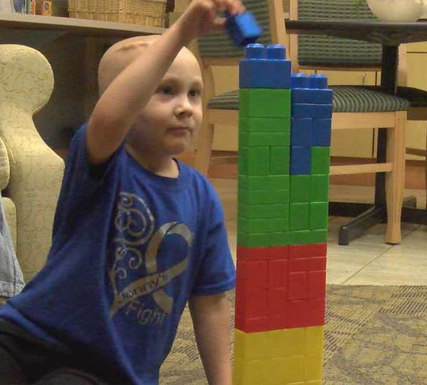 5-year-old, Jonny Milburn, playing with blocks as he battle cancer in Salem, Ohio.
