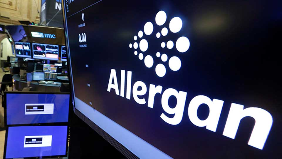 FILE - In this Monday, Nov. 23, 2015, file photo, the Allergan logo appears above a trading post on the floor of the New York Stock Exchange. On Wednesday, July 24, 2019, the medical device maker announced a worldwide recall of its Biocell breast implants which are linked to a rare form of cancer.