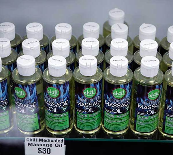 FILE - In this Nov. 7, 2018, file photo, bottles of massage oil with cannabidiol (CBD) and tetrahydrocannabinol (THC), two natural compounds found in plants of the Cannabis genus, are displayed at the Far West Holistic Center dispensary in Detroit.