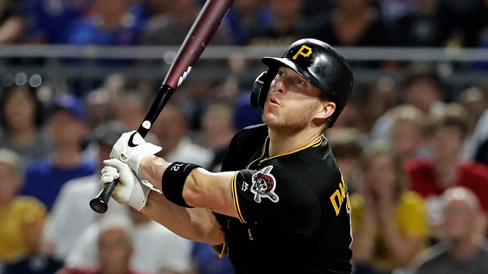 Pittsburgh Pirates' Corey Dickerson watches his game-winning sacrifice fly to left field
