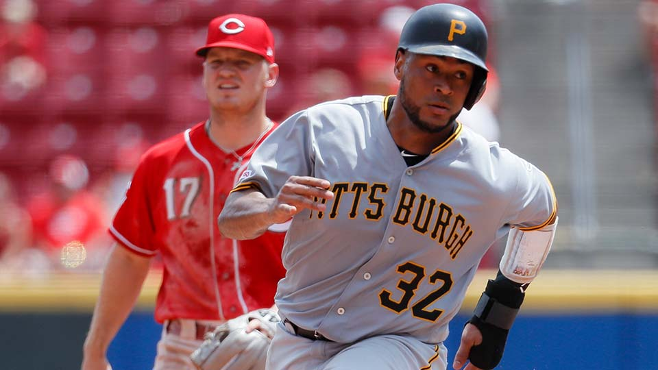 Pittsburgh Pirates' Elias Diaz runs to third on a double hit by Jose Osuna off Cincinnati Reds starting pitcher Luis Castillo