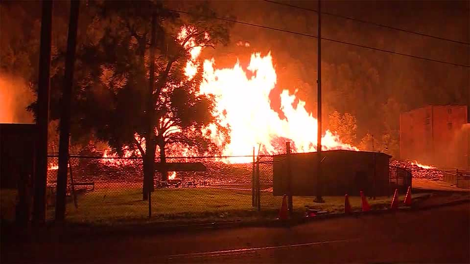 Firefighters in Kentucky are trying to extinguish a burning Jim Beam warehouse filled with about 45,000 barrels of bourbon.