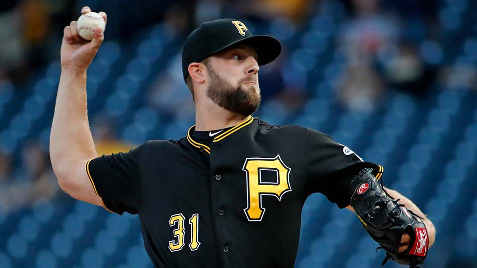 Pittsburgh Pirates starting pitcher Jordan Lyles delivers during the first inning of a baseball game against the St. Louis Cardinals.