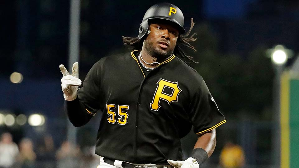 Pittsburgh Pirates' Josh Bell rounds third base after hitting a solo home run off Chicago Cubs starting pitcher Yu Darvish.