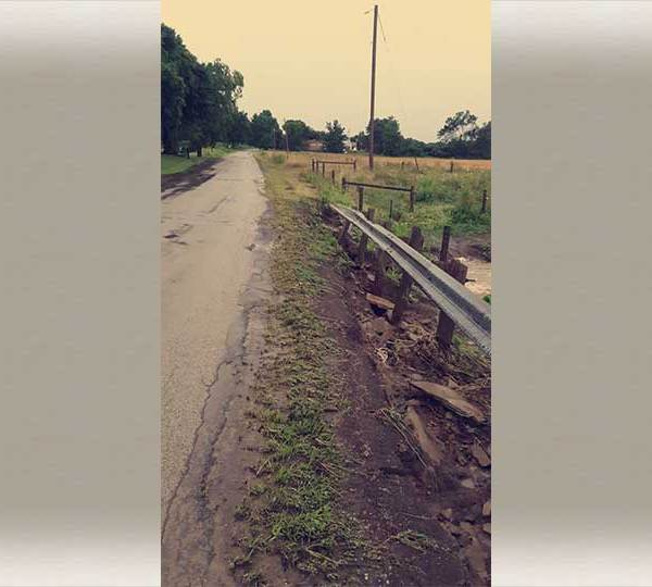 Flooding washed out the guardrails and parts of the road in Kinsman on State Street
