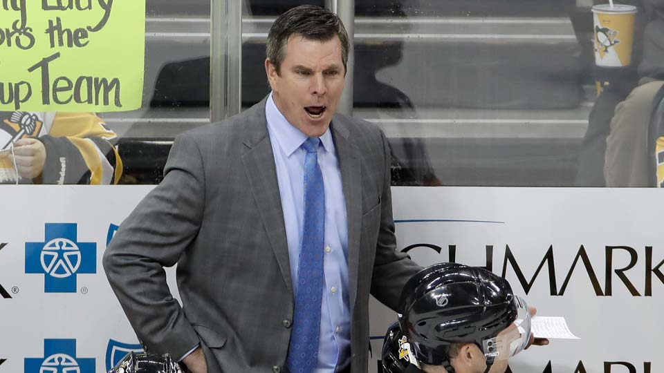 Pittsburgh Penguins head coach Mike Sullivan yells instructions during the third period of an NHL hockey game against the Chicago Blackhawks.