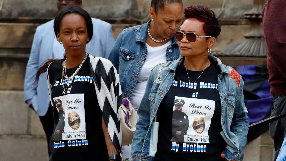 Joelle Jeffries, right, sister of fallen Pittsburgh Police officer Calvin Hall, is joined by her daughter Kiauna Jeffries as family members leave the Soldiers and Sailors Memorial in the Oakland neighborhood of Pittsburgh after a attending a viewing Monday, July 22, 2019. Officer Hall was shot Sunday, July 14, 2019 while off-duty in the Homewood neighborhood of Pittsburgh. A memorial service and funeral will be held Tuesday.