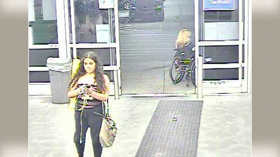 Authorities say a woman suspected of urinating on potatoes at a Walmart in Pennsylvania has turned herself in.