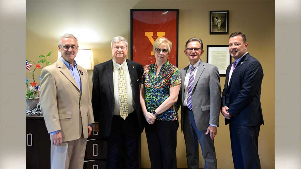 YSU President Jim Tressel; Hartman Foundation Board members Barry Haughin; Linda Cappelli; and Atty. Thomas Lodge; YSU Foundation Senior Development Officer Brian Nord.