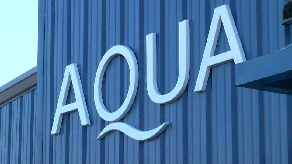 The Aqua Ohio sign on a building.
