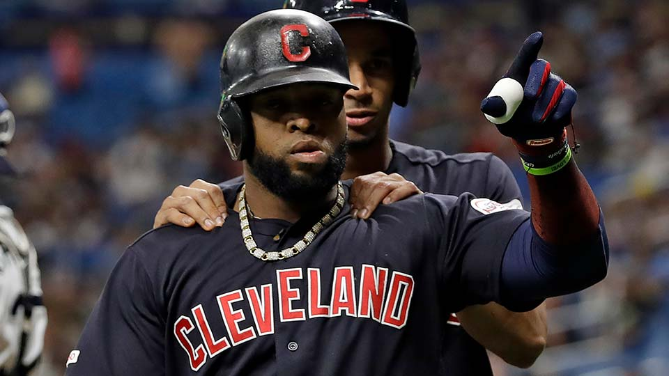 Cleveland Indians' Carlos Santana, front, celebrates with Oscar Mercado after Santana hit a two-run home run.