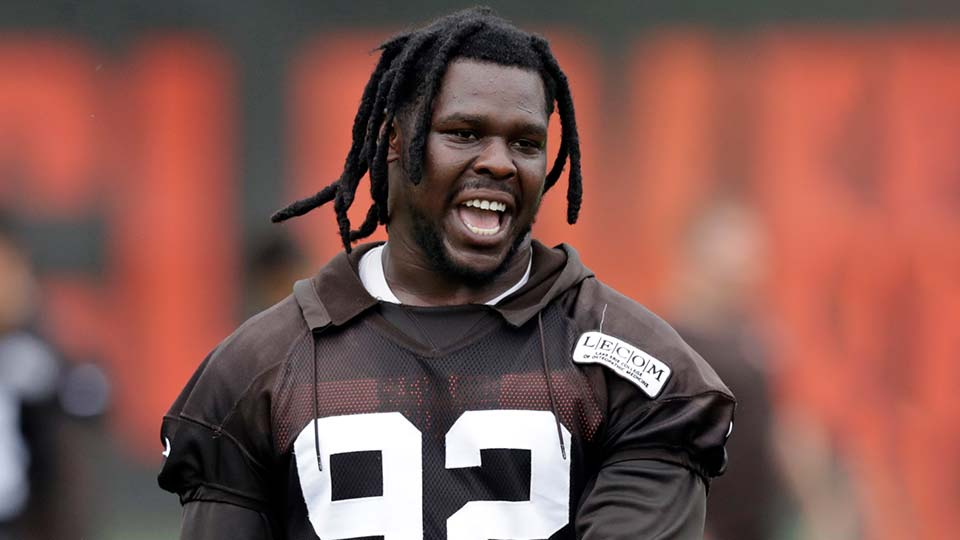 Cleveland Browns defensive end Chad Thomas walks off the field after an NFL football organized team activity session.