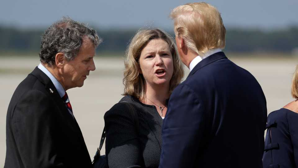 President Donald Trump is greeted by Dayton Mayor Nan Whaley and Sen. Sherrod Brown, D-Ohio, after arriving at Wright-Patterson Air Force Base to meet with people affected by the mass shooting in Dayton (AP Photo/Evan Vucci)