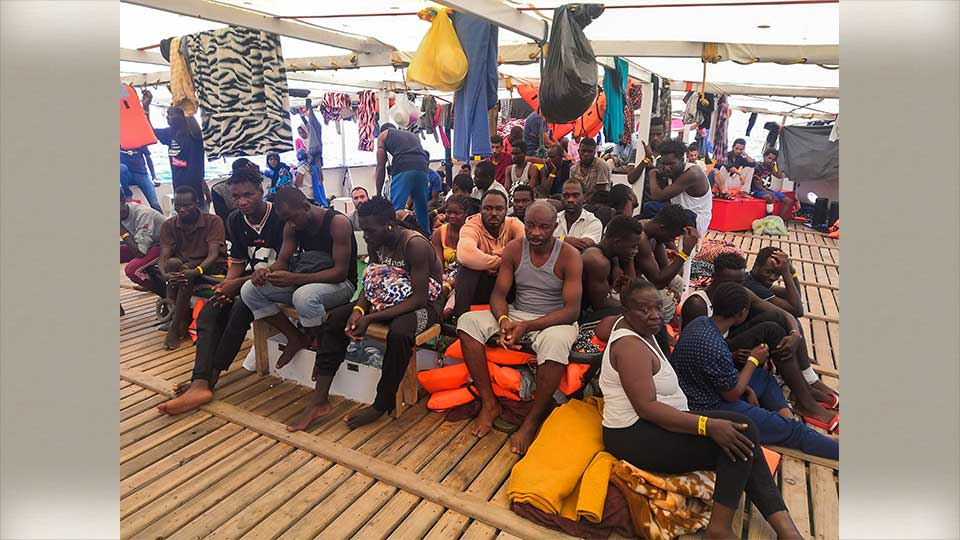 Migrants are seen aboard the Open Arms Spanish humanitarian boat as it cruises in the Mediterranean Sea, Friday, Aug. 9, 2019. Open Arms has been carrying 121 migrants for a week in the central Mediterranean awaiting a safe port to dock, after it was denied entry by Italy and Malta.