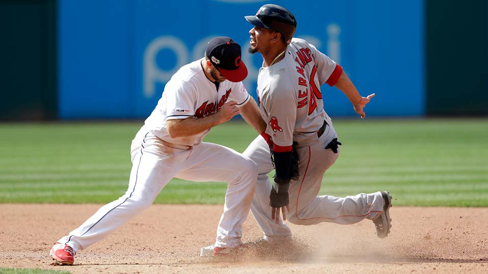 Cleveland Indians' Jason Kipnis, left, tags out Boston Red Sox's Marco Hernandez on a steal to second base.