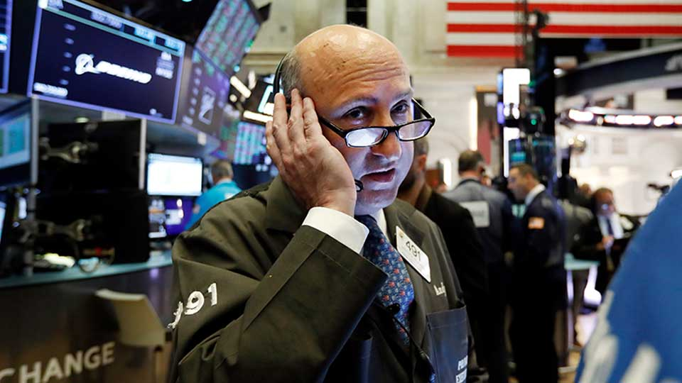 Trader Andrew Silverman works on the floor of the New York Stock Exchange, Thursday, Aug. 15, 2019. Stocks are rising on Wall Street early Thursday on indications American consumers continue to spend and embrace online shopping.
