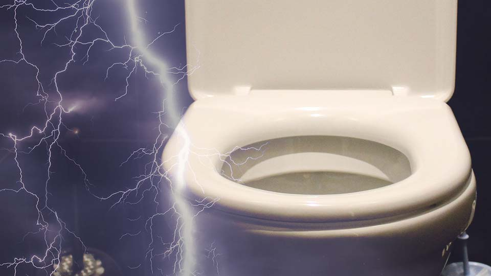 A lightning strike with a toilet in the background.