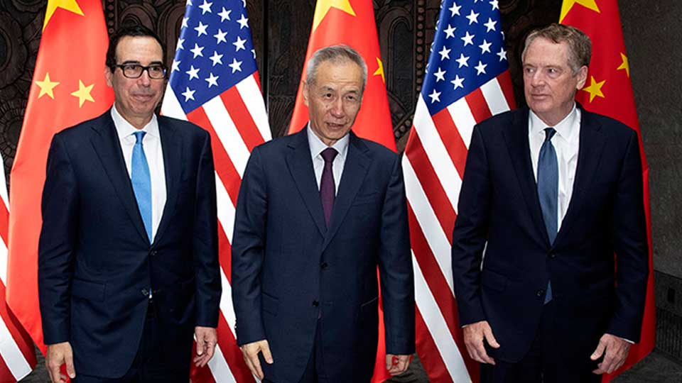 Chinese Vice Premier Liu He, center, poses with U.S. Trade Representative Robert Lighthizer, right, and Treasury Secretary Steven Mnuchin, for photos before holding talks at the Xijiao Conference Center in Shanghai Wednesday, July 31, 2019.