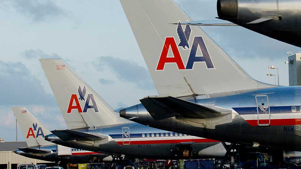FILE - In this Oct. 26, 2009 file photo, a row of American Airlines planes are parked at a terminal at Miami International Airport in Miami.