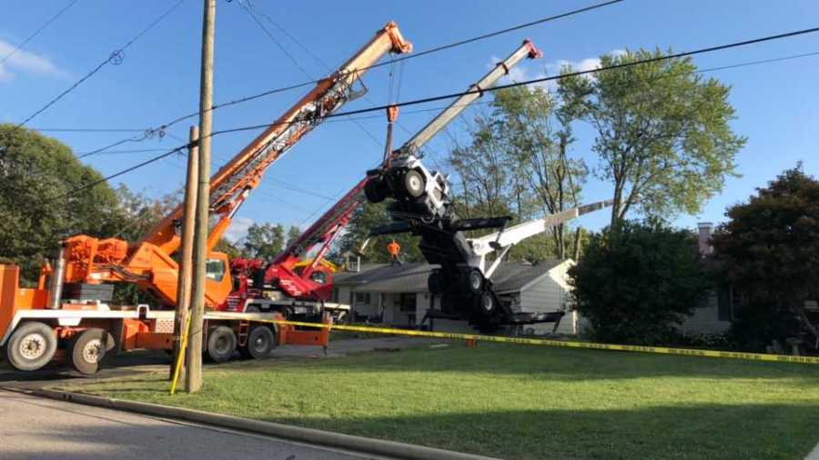 Tree trimming truck falls on Austintown house