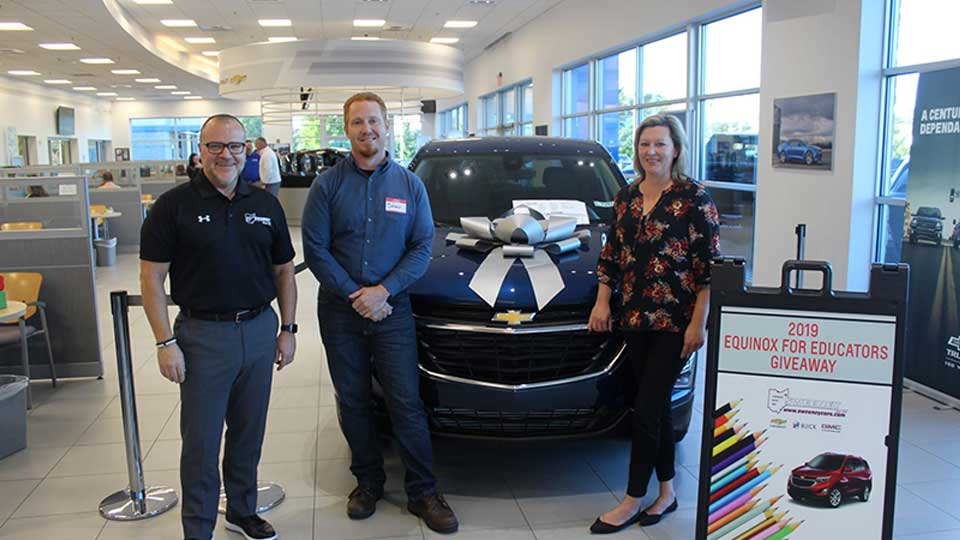L-R: Bobby Stackhouse (Partner, Sweeney Chevrolet Buick GMC), Steven Shurtleff, winner of the Equinox lease (Boardman High School), Alexa Sweeney Blackann (Vice President, Sweeney Chevrolet Buick GMC)
