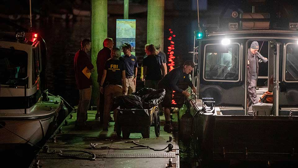 Authorities and FBI investigators cart away evidence taken from the scuba boat Conception in Santa Barbara Harbor at the end of their second day searching for the remaining divers still missing from the deadly pre-dawn fire on Tuesday, Sept. 3, 2019, in Santa Barbara, Calif. A fire raged through the boat Conception carrying recreational scuba divers anchored near an island off the Southern California Coast Monday, leaving multiple people dead.