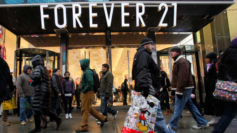 In this Dec. 26, 2010 file photo, people walk past a Forever 21 store in New York's Times Square (AP Photo/Mary Altaffer, file)