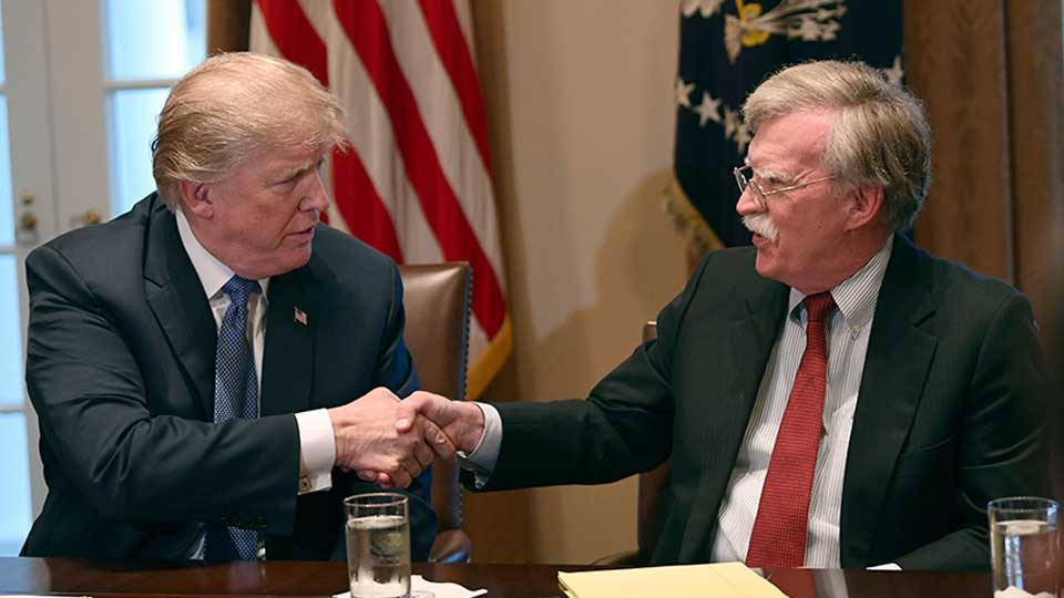 FILE - In this April 9, 2018 file photo, President Donald Trump, left, shakes hands with national security adviser John Bolton in the Cabinet Room of the White House in Washington at the start of a meeting with military leaders. Trump has fired national security adviser John Bolton. Trump tweeted Tuesday that he told Bolton Monday night that his services were no longer needed at the White House.