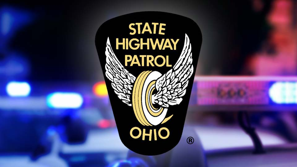 The Ohio State Highway Patrol logo in front of a police car and police lights.