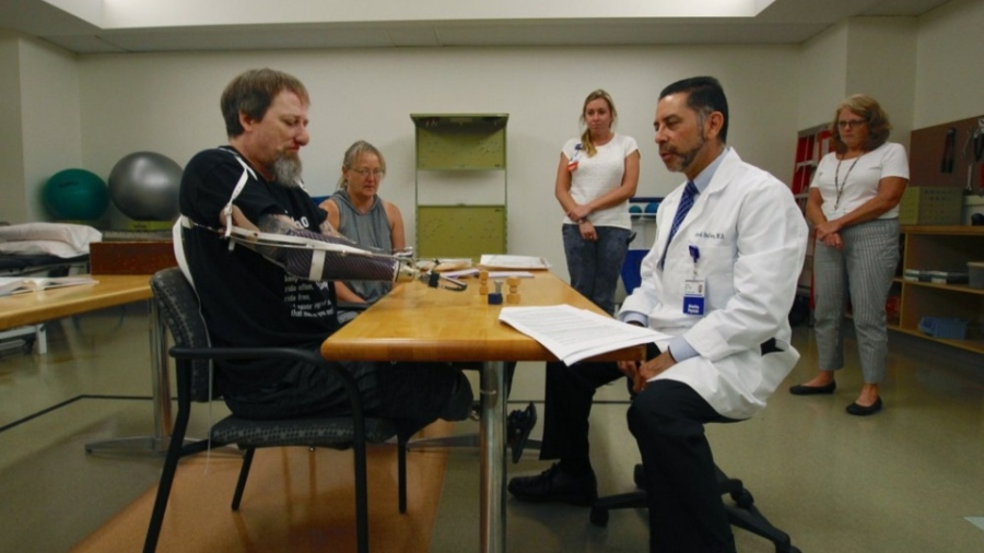 Manteufel tries out a new prosthetic arm