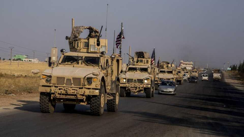 U.S. military convoy drives near the town of Qamishli, north Syria