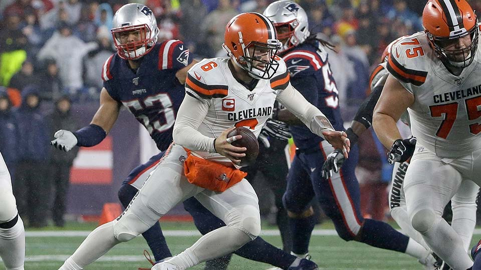 Cleveland Browns quarterback Baker Mayfield scrambles against the New England Patriots.