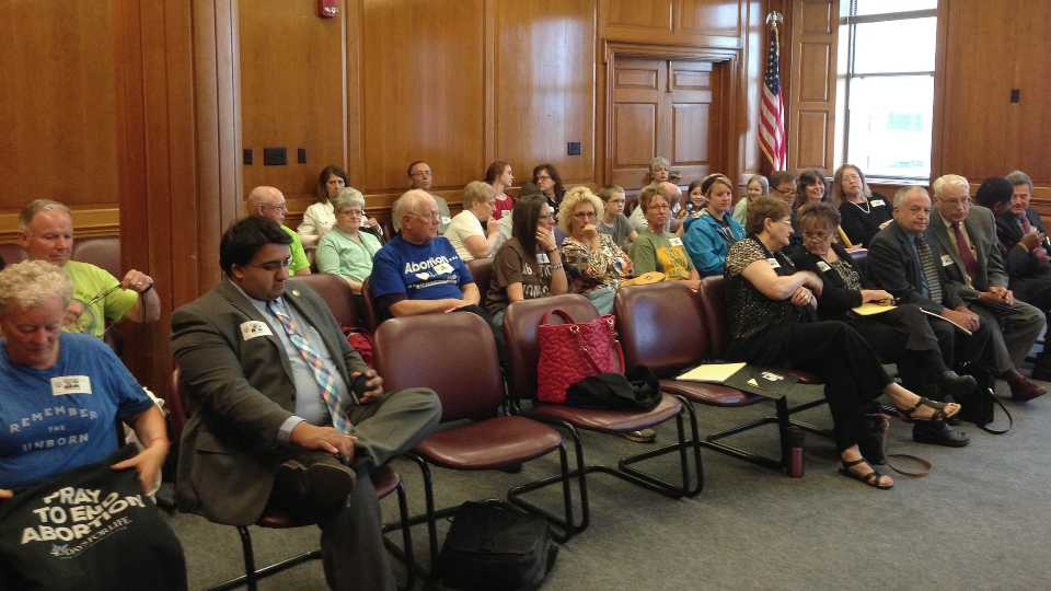 Dozens of people attend a hearing about an Ohio abortion clinic's license on Tuesday, April 26, 2016, in Columbus, Ohio. Anti-abortion activists packed a hearing to determine the fate of the clinic's license, as the facility's operators argued they are meeting emergency requirements laid out in a 2013 law that has contributed to clinic closures around the state. (AP Photo/Julie Carr Smyth)