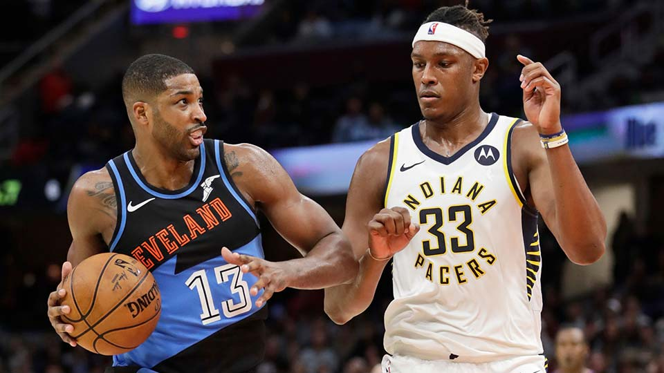 Cleveland Cavaliers' Tristan Thompson drives past Indiana Pacers' Myles Turner.