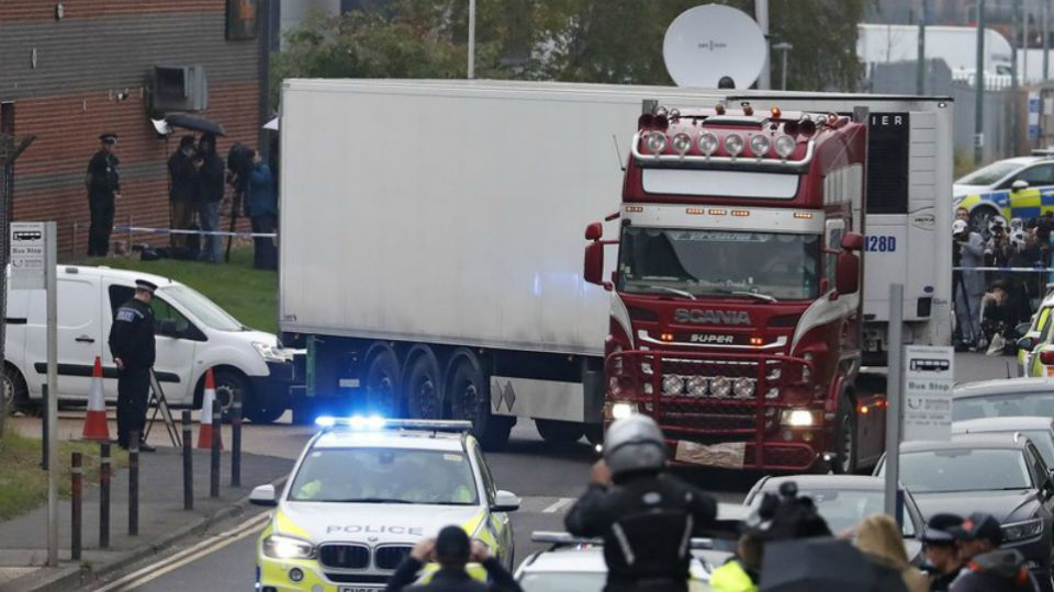 British police raided two sites in Northern Ireland and questioned a truck driver as they investigated the deaths of 39 people found in a truck container at an industrial park in southeastern England.