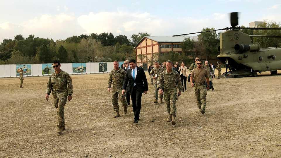 U.S. Defense Secretary Mark Esper, center, walks Gen. Scott Miller, right, chief of the U.S.-led coalition in Afghanistan, at the U.S. military headquarters in Kabul, Afghanistan (AP Photo/Lolita C. Balbor).
