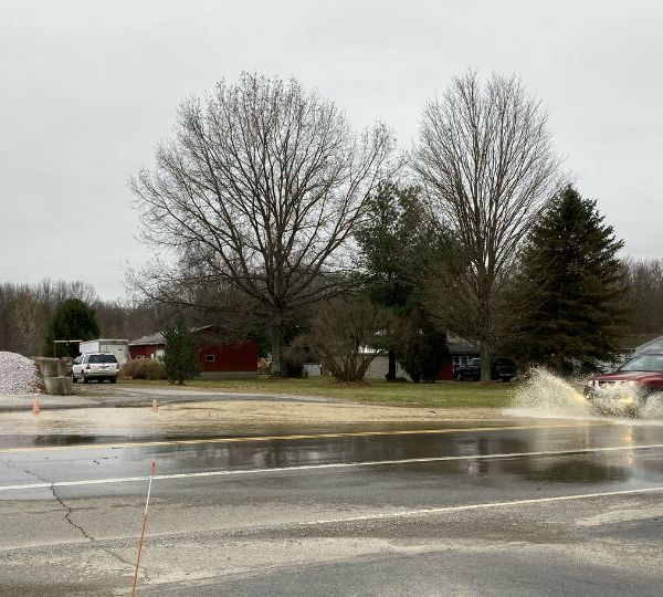 A road is flooded in Beaver Township following a water line break.