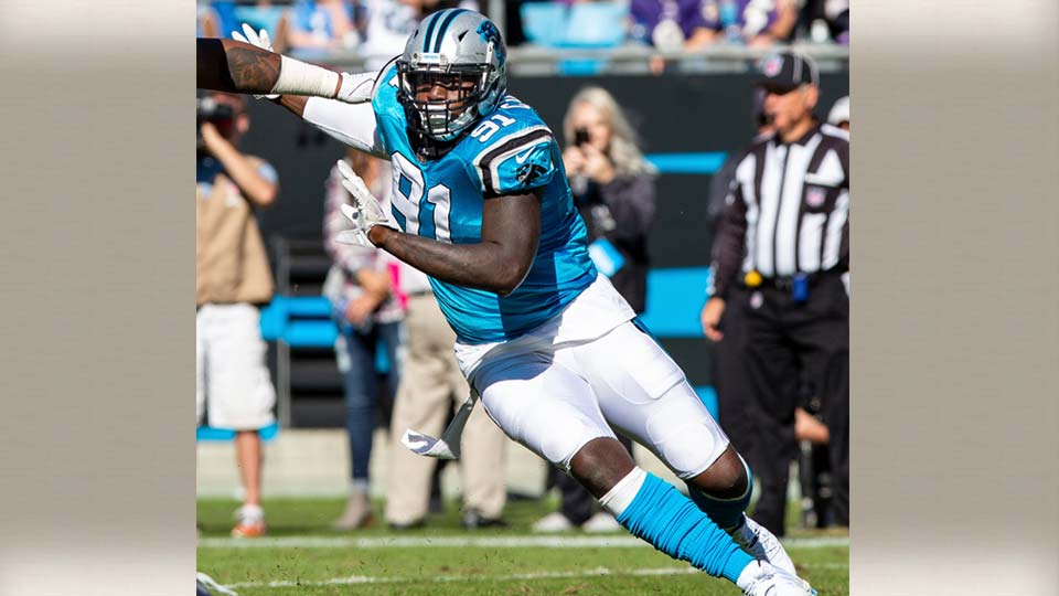 Carolina Panthers' Bryan Cox, Jr. (91) fights around a block during an NFL football game against the Baltimore Ravens in Charlotte, N.C., Sunday, Oct. 28, 2018. (AP Photo/Ben McKeown)