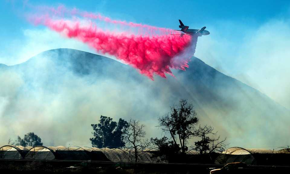 An air tanker drops retardant as the Maria Fire approaches Santa Paula, Calif., on Friday, Nov. 1, 2019. According to Ventura County Fire Department, the blaze has scorched more than 8,000 acres and destroyed at least two structures.