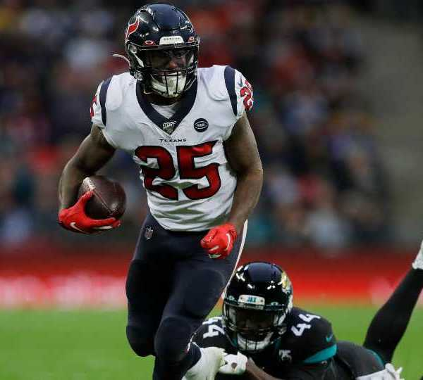Houston Texans running back Duke Johnson (25) runs against Jacksonville Jaguars middle linebacker Myles Jack (44) during the second half of an NFL football game at Wembley Stadium, Sunday, Nov. 3, 2019, in London.