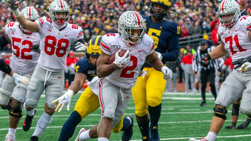 Ohio State running back J.K. Dobbins (2) scores a touchdown in the second quarter of an NCAA college football game against Michigan in Ann Arbor, Mich., Saturday, Nov. 30, 2019.