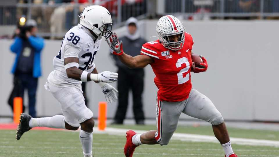Ohio State running back J.K. Dobbins, right, cuts up field against Penn State defensive back Lamont Wade during the first half of an NCAA college football game Saturday, Nov. 23, 2019, in Columbus, Ohio.